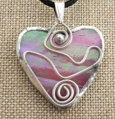 Small Iridescent Pink Stained Glass Heart Shaped Pendant with Wire Detail. $28.00, via Etsy.