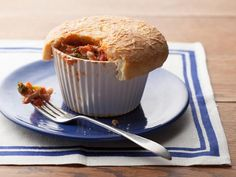 Giada transforms a family favorite, cheesy pizza, into individual Pizza Pot Pies loaded with chicken and broccoli.