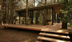 Fachada de casa de campo moderna Más