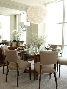 Dining Room | Sarah Richardson Design. I love this, because I have to have a paper chandelier that I plan on hanging above a round dining room table with fabric chairs. Great minds. Now, wasn't thinking the wall of mirrors - but adore the  effect. Lightness, bright, effortlessly simple, and truly elegant just like Ms. Richardson's style.