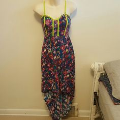 Xhilaration High Low floral dress This bright floral dress is perfect for spring/summer. It is a high low style with straps that can be removed. It has been lightly worn but is in perfect condition and has a lot of wear left in it! Xhilaration Dresses High Low