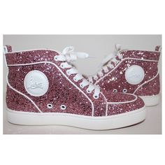 Christian Louboutin Pink Glitter Sneakers RARE  SOLD OUT! - Authentic Christian Louboutin Pink Glitter High Top Sneakers (White Leather Trim), size 39. Purchased at Saks Fifth Avenue. In new condition. Includes its original box/2 dust bags. Signature Louboutin circular nameplate on the side of each shoe. Leather insole w/ the Christian Louboutin name embossed at the heel pad. Red  white rubber soles that feature the Louboutin name. I also own these in gold. AMAZING to say the least! PM...