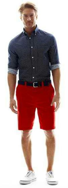 Just a great look: Oxford button colored shirt, dressed down. Rolled up sleeves,red shorts that are just about knee length, black belt and white sneakers. All he needs is laces for his shoes and possibly some kind of watch. Just an awesome Summer outfit!!