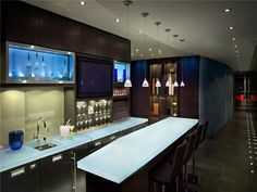 Kind of a w for white countertops and dark cabinets.  Def like the idea of backlighting for the um liquor