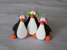 I handcraft my items from polymer clay. No molds or cutters are used.    These penguins are 2 1/2 high.