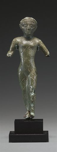 AN ETRUSCAN BRONZE FEMALE VOTIVE CIRCA EARLY 5TH CENTURY B.C.