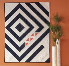 This modern quilt pattern download by Kacia Hosmer combines minimalism with beauty to bring you simply wall quilt.