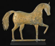 """Realized Price: $ 26,070   Waltham, Massachusetts prancing horse weathervane, ca. 1865, by A.E. Jewell & Co., with zinc head, molded copper body and sheet copper tail in original gold leaf surface, 15"""" h., 18"""" l. Literature: Art of the Weathervane, pg. 24. Provenance: Mary Page, Warner, New Hampshire."""