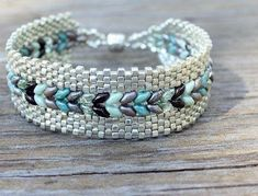Try this with my chocolate double-hole beads and multiple green seed beads (or silver seed beads)