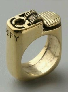 Antique lighter ring. I don't even smoke & I would love to own this beaut, cause, why the f**k not?