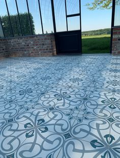 Conservatory with David & Goliath cement tile Angelo 20x20cm David And Goliath, Cement Tiles, Conservatory, Warehouse, Tile Floor, Wood, Modern, Design, Trendy Tree