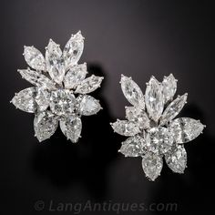 A red carpet must have! These sensational sparklers contain 8 carats of bright white, high-quality diamonds in EACH earring (16 carats total). The classic overlap design centers on a fine round brilliant cut diamond wrapped with both pear and marquise cut diamonds. Absolutely fabulous! Hand made platinum settings; circa 1960. Clip backings.