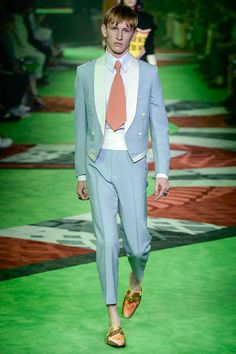 Gucci Spring 2017 Menswear Fashion Show  Lines & Color Palette On one hand: I like the Alice in Wonderland look. On the other hand: WHAT THE HELL IS THAT!?