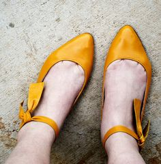 Ankle tie shoes.