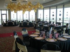 Love the gold balloons and red carpet. Popcorn containers at each seat to hold favors