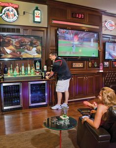 the homeowner pours his wife a drink from the jagermeister tap sportsbar basement sports bar ideas
