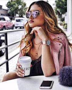Pink sunglasses, pink leather jacket, and drinking Nordstrom coffee. - Cliche coffee shop shot