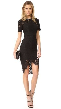 This formfitting Lover lace dress is finished with an angular hem. Short sleeves. Hidden back zip. Optional slip-dress lining.