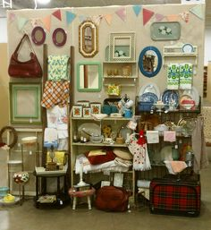 This is such a cute idea for a small booth at an antique mall or show. LOVE the use of the wall and shelving. This booth belongs to Danavee of This Vintage Grove - http://eevanad.blogspot.com/search?updated-max=2012-04-04T06:03:00-05:00=7