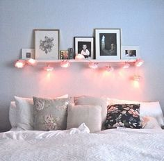 Liking the shelf with fairy lights above bed