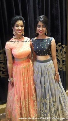 Our client Sneha (L) and her friend are all dolled up for their special occasion. Makeup and hairstyle by Swank Studio. Lehenga. Red lips. Gold jewellery. Maang tikka. Hairstyle. Find us https://www.facebook.com/SwankStudioBangalore