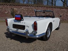 Triumph TR4 official UK Police car fully restored, completely documented, last remaining police car | Gallery Aaldering
