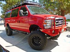 Check out the custom red bumper!  Aluminess bumpers, roof rack, ladders and nerf bars.