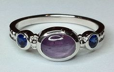 White gold, Purple-pink Star sapphire and faceted blue sapphire eternity ring