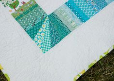 love this photo of using a paper-pieced square for each of the string border corners