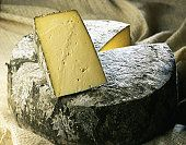 """Edible nettles are used to flavour  Cornish Yarg from Lynher Dairies Cheese Company in Cornwall. The nettle leaves are brushed onto the cheese to attract """"wonderful natural occurring moulds of various colours"""". As the cheese matures, the nettles infuse a """"delicate, slightly mushroomy taste""""."""