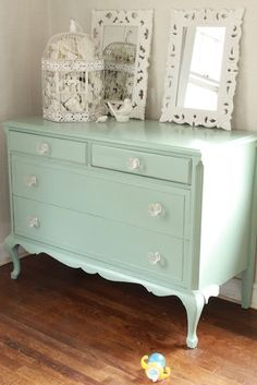I am obsessed with this color right now!!! And I love the glass knobs. SO feminine.