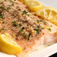 Baked salmon recipe seasoned with garlic, roasted lemons, and fresh herbs. A healthy family dinner ready in just 30 minutes. Baked salmon recipe seasoned with garlic, roasted lemons, and fresh herbs. A healthy family dinner ready in just 30 minutes. Healthy Dinner Recipes, Healthy Snacks, Cooking Recipes, Baked Salmon Recipes Healthy, Salmon With Skin Recipes, Salmon Salad Recipes, Vegetarian Recipes, Fish Dishes, Seafood Dishes