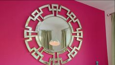 Aztec round mirror featured on hot pink wall! As seen on Cowboy Builders & Bodge Jobs