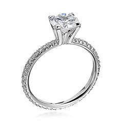 From the Michael B Princess Collection, Michael B's signature ring the petite princess features a solitaire mounting with .29TW of eternity micro pave diamonds set in platinum. This setting is available in several metal options. Setting can hold various diamond shapes. Price reflects setting only.