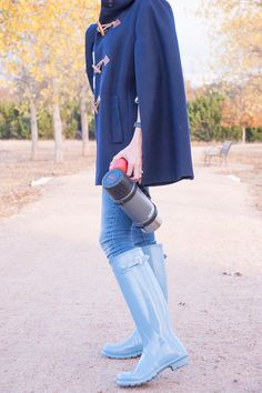 Navy J. Crew cape, hunter boots, striped sweater-fall outfit