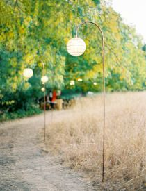 These hanging lanterns provide a simple eye level glow for any walk way.