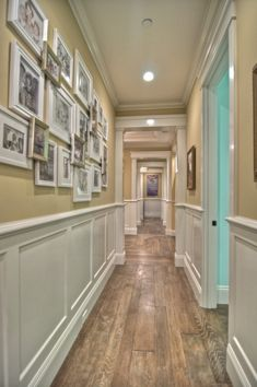 Gallery wall in long hallway with overlapping frames