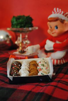 elf donuts - Cheerios with frosting & sprinkles, powdered sugar