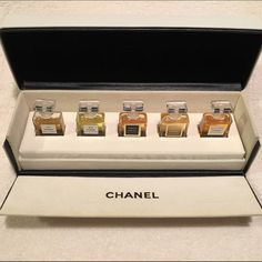 Chanel Perfume Fragrance Wardrobe Coffret Set 5 miniature bottles of Chanel perfumes: Chanel No. 5, No 19, Coco, Coco Mademoiselle, & Allure each 0.12 fl oz (3.4 ml) in EDP (eau de parfum). Set includes the lovely gift box to display them in. White box with flocked interior with black Chanel lettering. Exterior is a leather-like white material with the black Chanel CC logo imprinted on the lid. Comes with outer cardboard box showing proof of purchase. More pics to come of close ups of the…