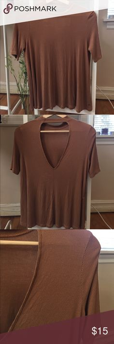 American Eagle brown/orange turtleneck tee From American Eagle, size small. It's a brownish orange, and the collar goes up to the neck and fits like a choker. American Eagle Outfitters Tops Blouses