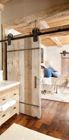 Rustic Bedroom by Peace Design. Barn doors on the bedrooms too to save space? No awkward bumping into people.