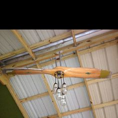 A wooden airplane prop and mason jars made into a lighting fixture. I need to make this for my pilot!