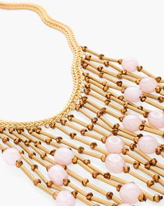 "Pink Ginger Bib Necklace in Pink $99.  A Jazz-Age jewel. With cascading, gilded fringe accented with pops of pale pink, this glam bib necklace is reminiscent of the Roaring '20s.  Individual style. Clean, modern lines. The Exclusive Black Label by Chico's™ collection.  Dimensions: 16"" in length, plus 4"" extender chain.  Metal, glass, plastic, silk and cubic zirconia."