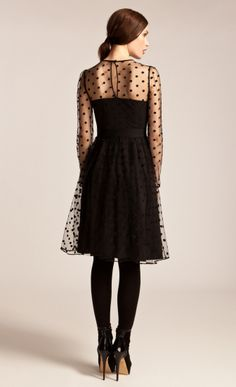 Made using large flocked polka dot tulle, the ALICE by Temperley Celia Dress has a classic 1950s shape with nipped in waist and flared skirt. The neck yoke and long slim sleeves are sheer, tantalisingly revealing the skin beneath the polka dots. A ruched central panel runs down the dress while the waist is accented with a single grosgrain ribbon.Fabric Composition: 100% Viscose, Lining; 100% PolyesterTrue to sizeModel is 5ft 10 and is wearing a size 8