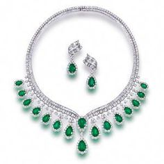 An emerald and diamond necklace and pendant earrings Sold for US$ 170,500 inc. premium #diamondnecklace