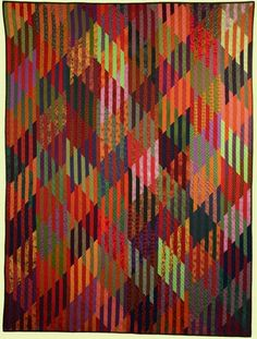 """Staggering 1"" by Kent Williams  Using commercial fabrics, Kent machine-pieces and machine-quilts his works."