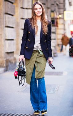 Carlotta Oddi in a navy blazer and flared jeans