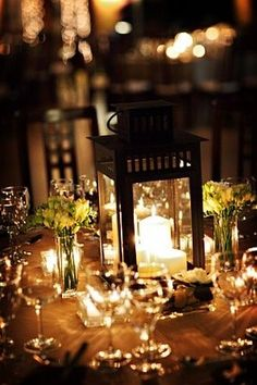 Awwww I love it. Lantern Wedding Centerpieces with flowers and more candles around the table!!! A little height but not too much!
