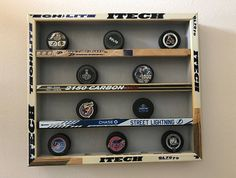 Hockey Puck Display Case holds 20 pucks hockey sticks