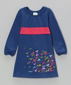 Little ones play freely this comfy yet subtly styled frock. Made with organic cotton, it sashays with every step, and a playful print adds extra flair.